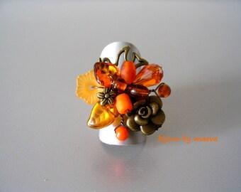 Costume jewelry ring orange and brown beads Birds