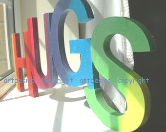 Wooden letters sign HUGS