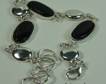 Silver bracelet onyx and spacers.