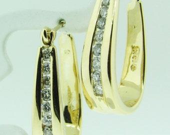 14 K gold and diamond hoop earrings.