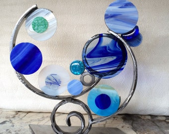 Blue Surf - a steel and glass sculpture