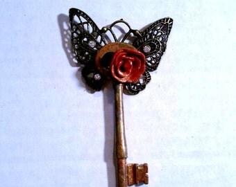Butterfly rose skeleton key pendant