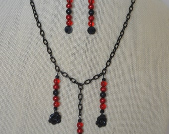 Bird and flowers black and red necklace and earrings