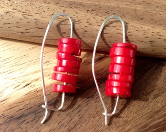 Coral and silver earrings.