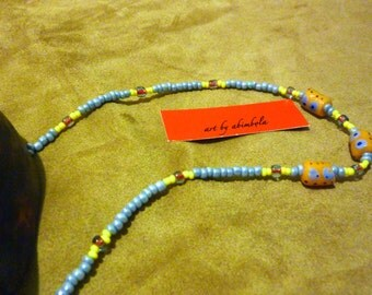 Beaded necklace with traditional Ghanaian trade beads in yellow and lilac