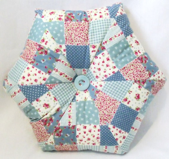 "hexagonal scatter cushion, faux patchwork floral throw pillow, blue pointed accent pillow with decorative co-ordinating button, 16"" across"