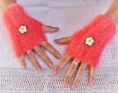 Fingerless gloves hand knitted fluffy hot coral mohair cozy cuffs cream crochet brass flower detail, luxury yarn, ribbed, warm soft light