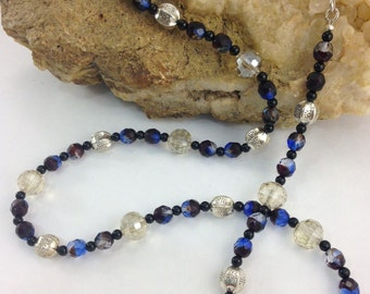 Garnet Red and sky blue fired bead 31-inch necklace with black Onyx spacer bead.