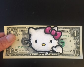 Hello Kitty painted on a dollar
