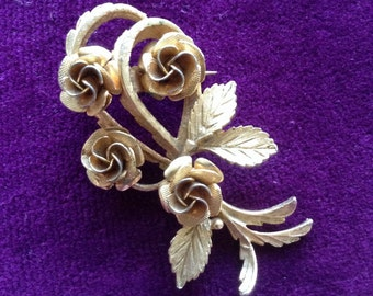 Brooch. Very stylish with flower design.