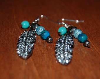 Silver feather with aqua and blue beads dangle earrings