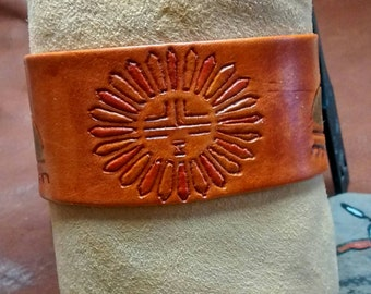 Tribal sun and clouds leather cuff