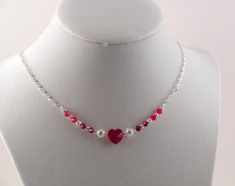 Red Swarovski crystal heart necklace.  Silver accents.  Adjustable.