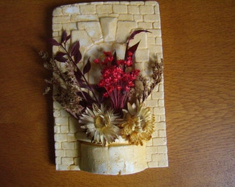 Original wall plaster and dried flowers