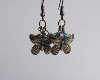 Antique gold butterfly earrings with emerald and amethyst beads