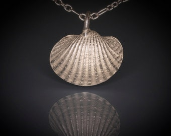sterling silver sea shell necklace. ocean life sea shell pendant. handmade cast jewelry. nature inspired