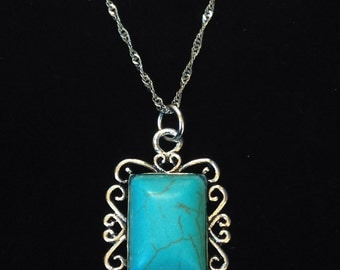 Tibetan Silver Pendant With Synthetic Turquoise Stone