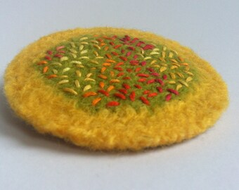 Scattered Seeds: a large colourful embroidered felt brooch