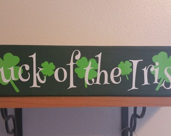 Luck of the Irish board with clovers