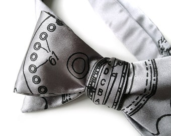 Enigma bow tie. Early encryption machine men's bowtie. Cryptography World War II history silkscreen bowtie. Geek chic gift.