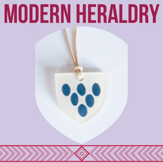 Modern Heraldry Shield Necklace | Six Slate Grey Oval Repeated Charge Design on Fawn Waxed Cotton