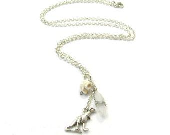 T-Rex Crystal Pendant Charm Necklace - Silver Dinosaur, Howlite Skull, & Quartz Crystal Prehistoric Lucky Charm Necklace