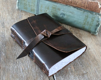 """Leather Travel Journal . """"The world is a book and those who travel read only one page"""" - Augustine of Hippo . handmade handbound (320p)"""