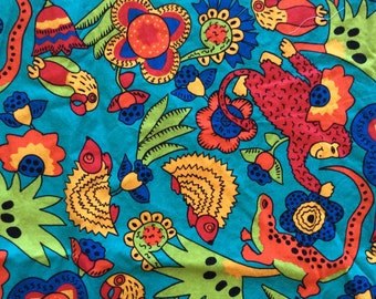 Robert Kaufman tropical animal print, parrots, monkeys, porcupines, lizards, flowers, in turquoise, red, orange, yellow, 2 1/2 yds available