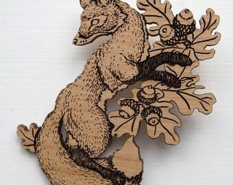 Dancing Fox and Oak engraved alder wood brooch