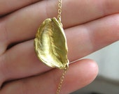 Golden seed pod pendant necklace. Gold plated sterling silver seed pod on gold filled chain. Botanical jewelry.