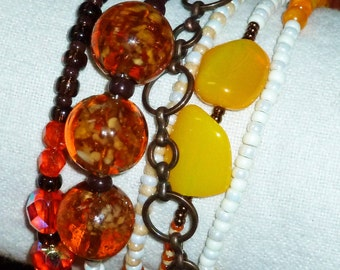 Autumn - a wrap bracelet with the fall colors of orange, yellow, copper, topaz and brown