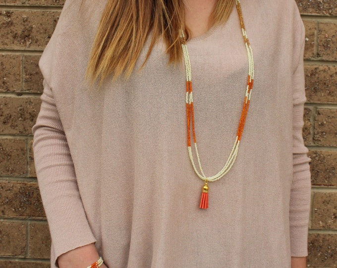 Orange Layered Beaded Tassel Necklace.
