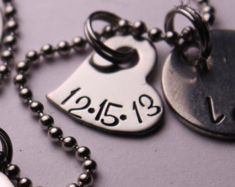 Add small stainless steel heart to a necklace with date or name (up to 6 letters/numbers)