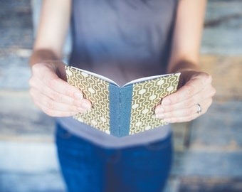 Small handmade book with gold honeycomb cover, perfect for wedding vows or honeymoon memories