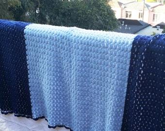 Vintage navy blue, light blue, and white crochet afghan