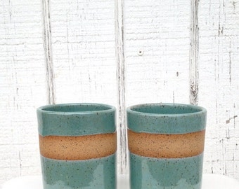 tumblers cup mug ceramic in shiny turquoise and tan clay