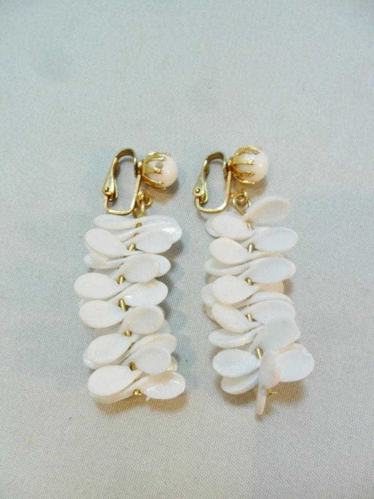 vintage earrings signed hong kong white lucite clip by