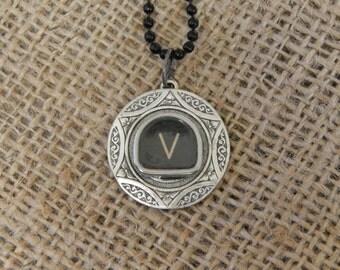 Typewriter key necklace, letter V on a black tombstone key, silver toned floral patterned pendant