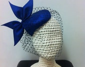 Parasisal headpiece with custom bow and veil