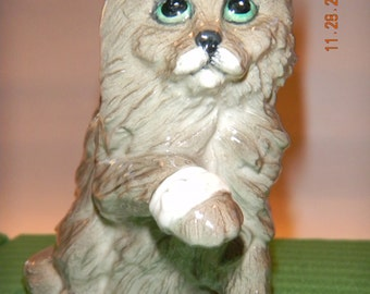 Vintage Royal Doulton bandaged cat figurine...comes with box..lovely face..glazed grey cat