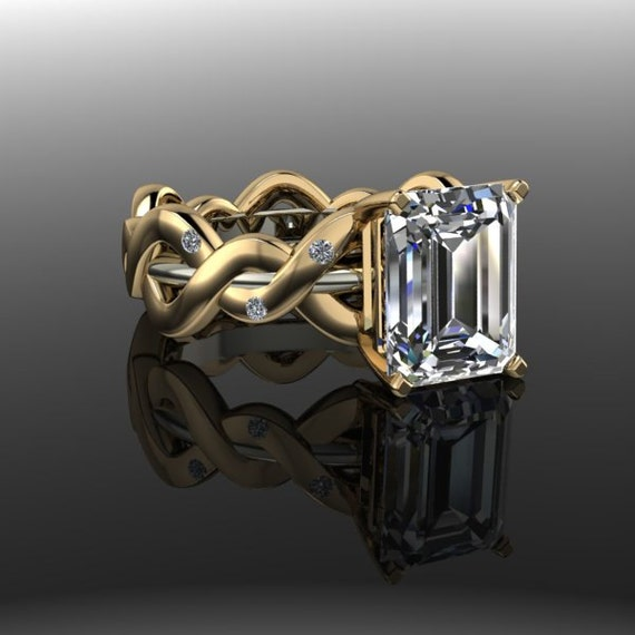 moissanite engagement ring emerald cut by belviaggiodesigns