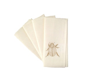 Christmas beetle gold on off-white linen napkins (set of 4)