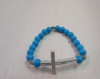 Beautiful silver sideway cross with blue beads