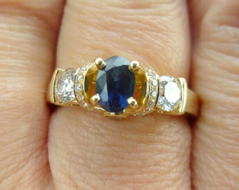 Custom  Sapphire and Diamonds in HEAVY 14KT Yellow  gold  total  carat weight  is 1.26 points
