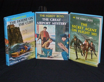 "The Hardy Boys Vol 2,9,46 ""The House on the Cliff 1959 1st Ed"" ""The Great Airport Mystery 1965 1st Ed"" ""The Secret Agent on Flight 101 1967"""