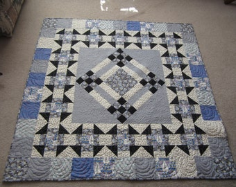 PDF pattern Lady Rose Downton Abbey Inspired Lap quilt using Andover Fabrics in blue and purple in a medallion style quilt, churn dash 1920s
