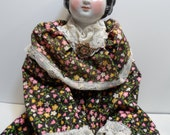Antique German Porcelain Doll, Covered Wagon Hairstyle, Cloth Body, Guilloche Enamel, Rhinestone Brooch and Hand Made Dress