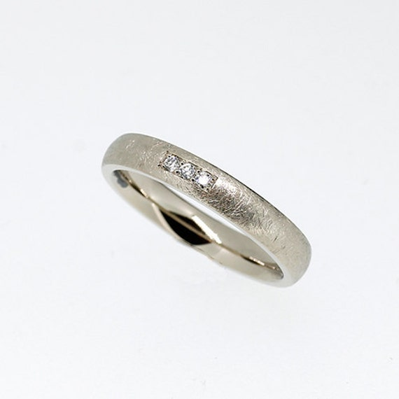 scratched white gold wedding band with by torkkelijewellery