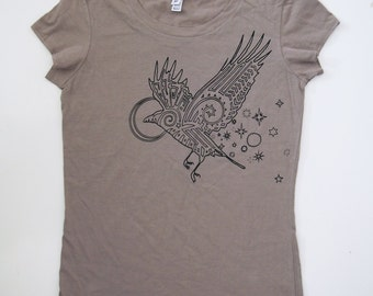 Black Raven printed on a Womens Soft Pebble Gray Jersey 100% Cotton T-shirt