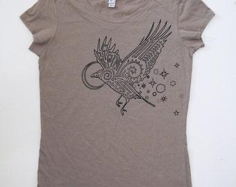 Black Raven printed on a Womens Soft Pebble Gray Tee Shirt